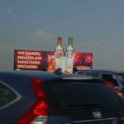 Leverage premier advertising placements by placing large billboard signs in